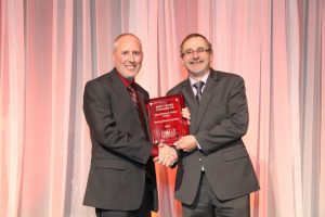Warrick Butler being presented the 2011 AHW Customer Choice Award by Vic Rowe