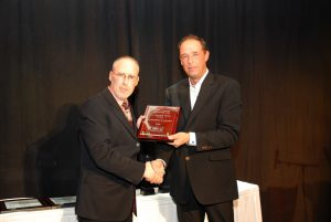 Warrick Butler being presented the AHW Customer Choice Award by an AHW board member