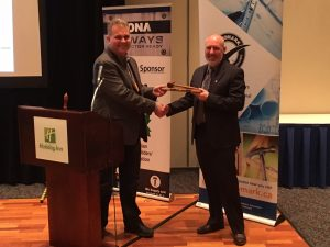 Warrick Butler being presented with the CHBA-NL gavel