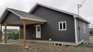 Covered veranda of dark grey house