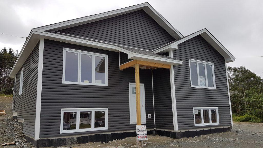 Dark grey split-entry bungalow house with white door