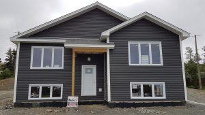 Dark grey split entry house with white door