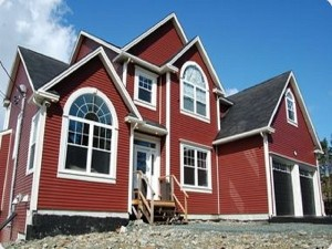Large red two story house with multiple roof peaks and lots of big windows