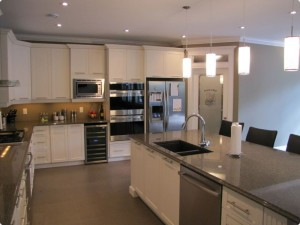 Kitchen with white cabinets centre island and pantry