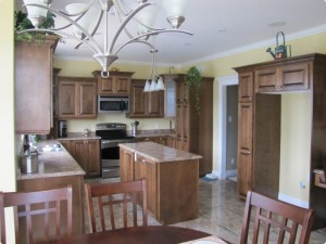 Large kitchen with centre island and stainless steel appliances