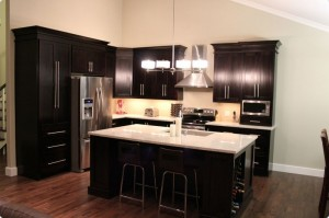 Kitchen with dark cabinets and island with light counter top