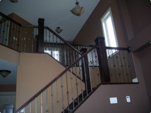Dark stairs with wrought iron spindles