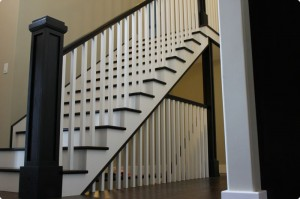 Stairs with white spindles and dark post and treads